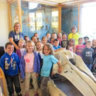 Large group of grade school kids at the museum