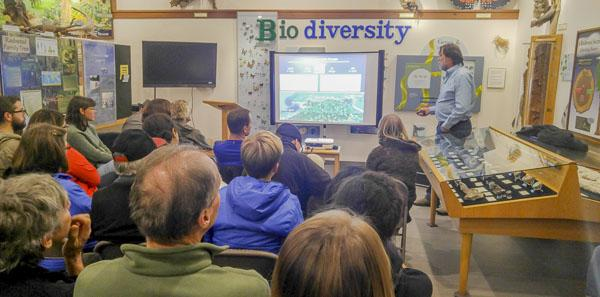 an audience at a monthly speaker series - watching a presentation
