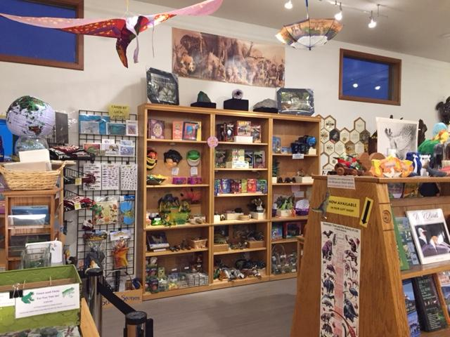 Photo of the store inside the museum - lots of shelves with things for sale