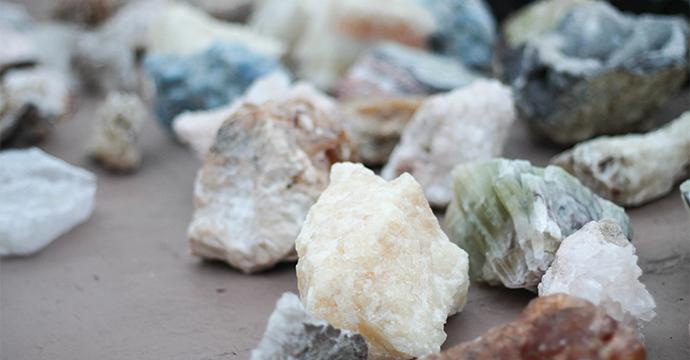 A photo of many rock and mineral groups on a table